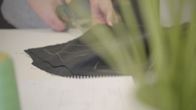 4K: Woman Cutting Textile