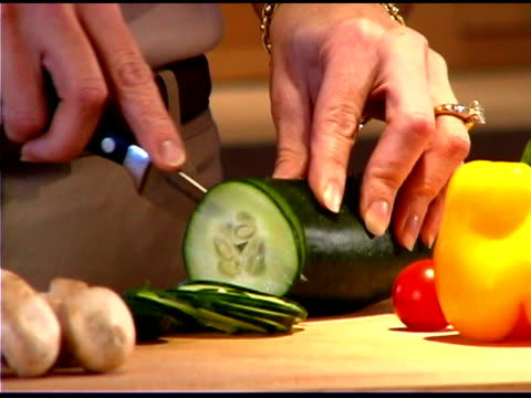 woman cutting vegetables - one mature woman only stock videos & royalty-free footage