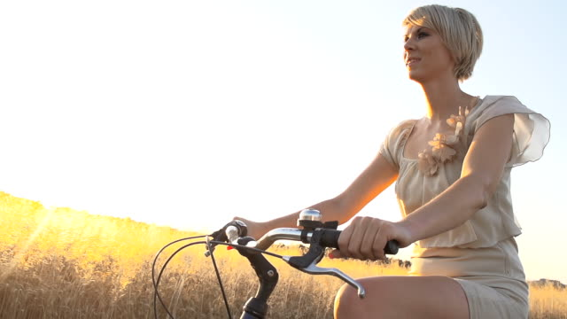 HD SUPER SLOW MO: Woman Cycling In Countryside