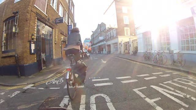 woman cycling in london - cycling stock videos & royalty-free footage
