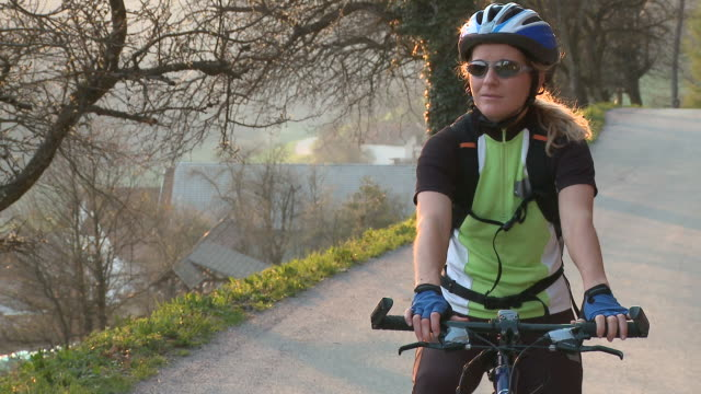 ms ds woman cycling in rural landscape, vrhnika, slovenia - vrhnika stock videos & royalty-free footage