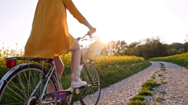 slo mo woman cycling in the countryside - springtime stock videos & royalty-free footage