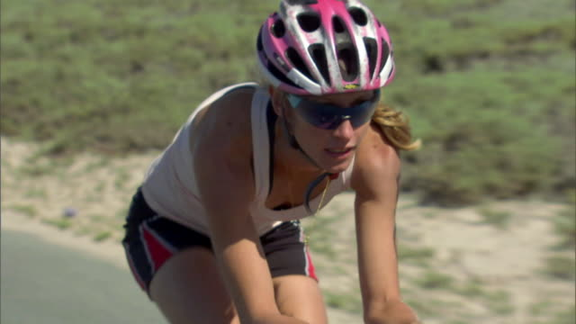 ts cu td woman cycling on remote road during race / strandfontein, western cape province, south africa - helmet stock videos & royalty-free footage