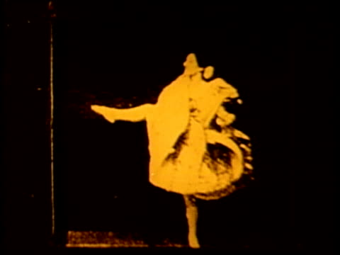A woman dances and does somersaults