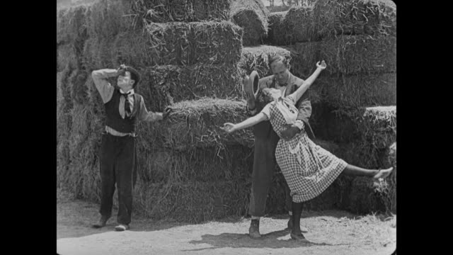 1920 woman dances before haystack - silent film stock videos & royalty-free footage