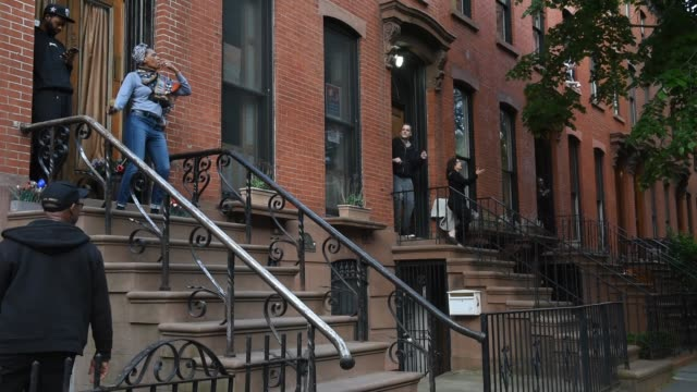 woman dances on their stoop at 7:00 pm to honor frontline medical workers during the coronavirus pandemic on may 12, 2020 in the brooklyn borough in... - doorstep stock videos & royalty-free footage