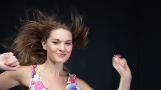 ms woman dancing and flicking hair around in wind / london, greater london, united kingdom - greater london video stock e b–roll