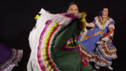 Woman dancing and twirling dresses