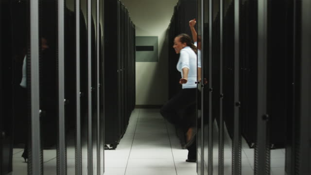 woman dancing in a server room - jamaican ethnicity stock videos & royalty-free footage