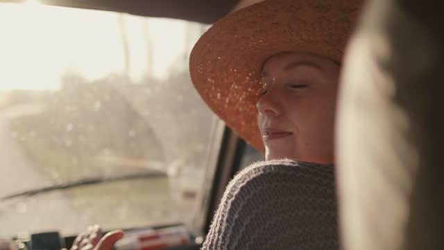 woman dancing in passenger seat on road trip - passenger seat stock videos & royalty-free footage