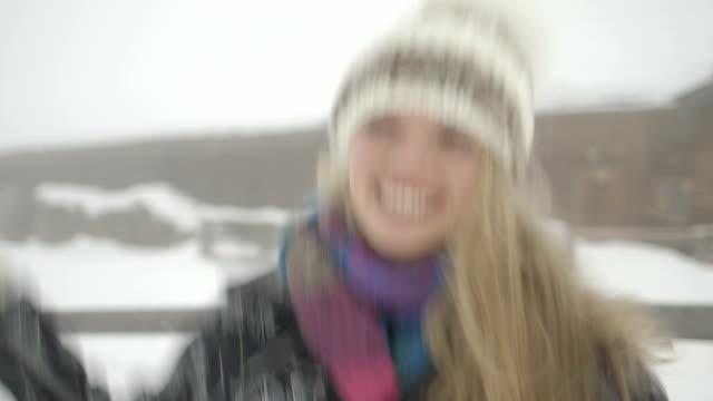 woman dancing in snow - ski jacket stock videos & royalty-free footage