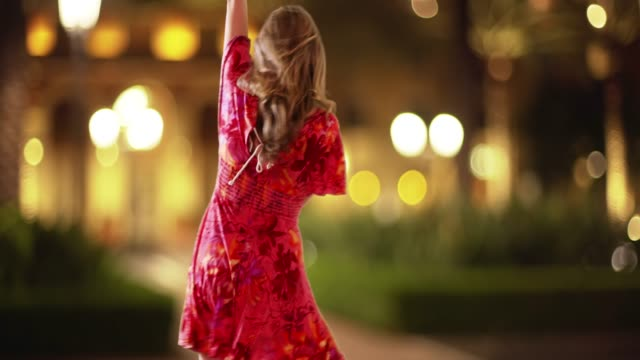 woman dancing in sundress on street downtown in the evening - sundress stock videos & royalty-free footage