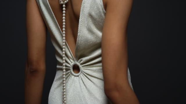 vídeos de stock, filmes e b-roll de woman dancing in white gown - roupa formal
