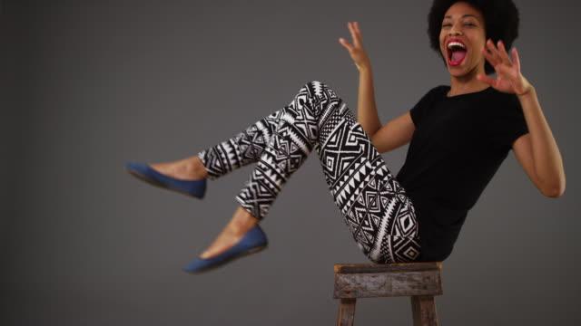 woman dancing on chair