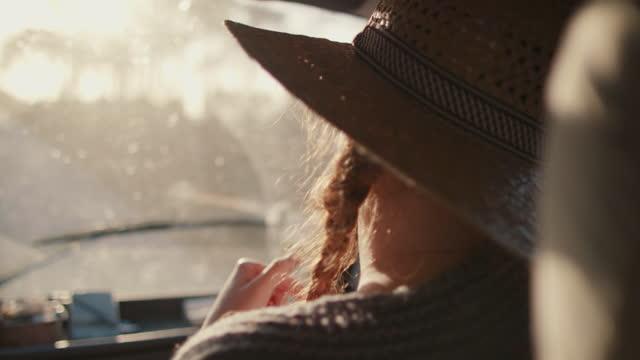 woman dancing on passenger seat in camper van on road - passenger seat stock videos & royalty-free footage