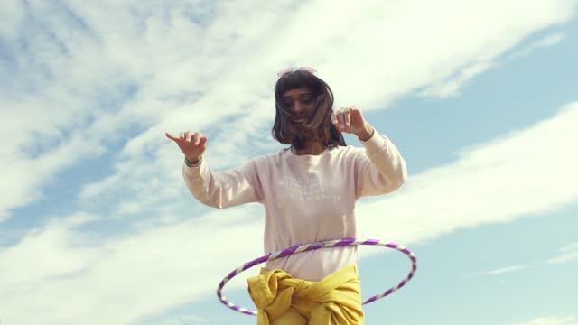 woman dancing with a hula hoop - hobbies stock videos & royalty-free footage