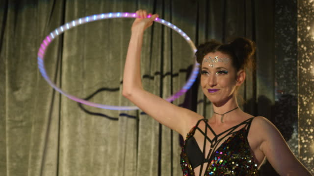 woman dancing with luminescent plastic hoop - cabaret stock videos & royalty-free footage