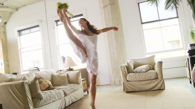 woman dancing with sunflowers