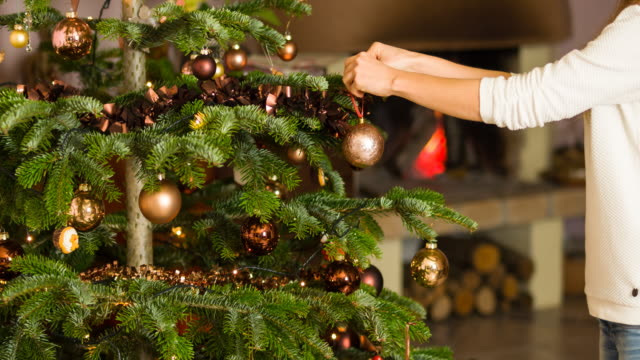 woman decorating christmas tree - hanging stock videos & royalty-free footage