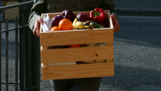 woman delivering food - crate stock videos & royalty-free footage