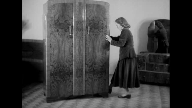 woman demonstrates a movable wardrobe at the earls court furniture exhibition. - earls court stock videos & royalty-free footage
