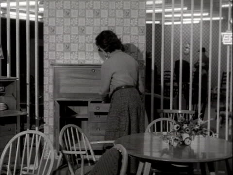 woman demonstrates contemporary furniture at a furniture exhibition at earls court exhibition centre. - earls court stock videos & royalty-free footage