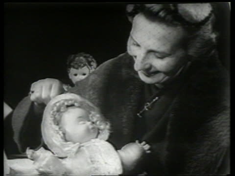 b/w woman demonstrating doll with 3 faces / sound - doll stock videos & royalty-free footage