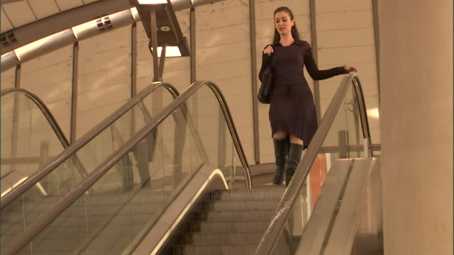 ms, la, cu, woman descending escalator, olympic park railway station, sydney, australia - escalator stock videos & royalty-free footage