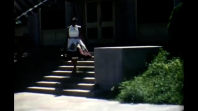 1955 woman descending steps - sleeveless top stock videos & royalty-free footage