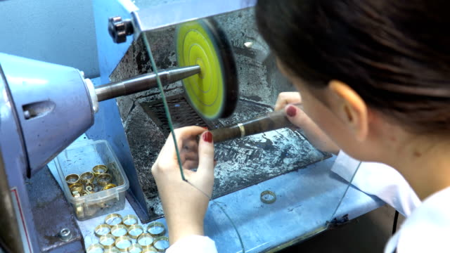 woman designer makes and design jewelry in workshop - making stock videos and b-roll footage