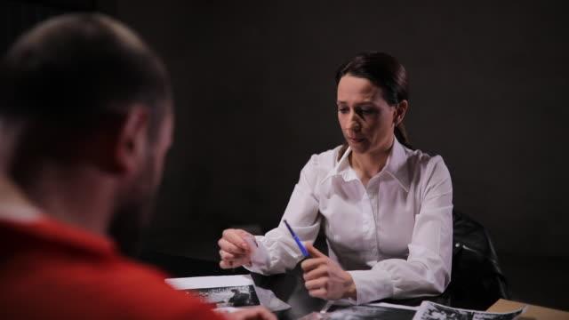 woman detective and prisoner in interrogation room - prisoner orange stock videos & royalty-free footage