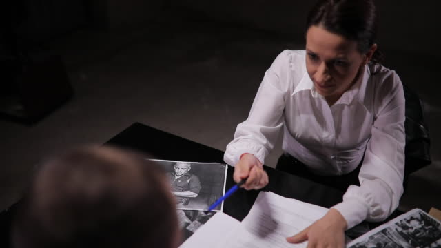 woman detective interrogating a prisoner - prosecutor stock videos & royalty-free footage