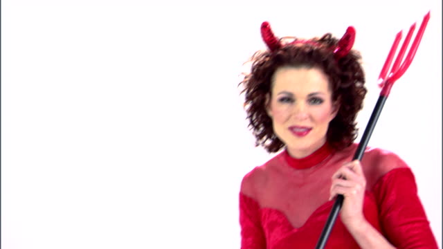 vídeos y material grabado en eventos de stock de woman devil with trident - bieldo equipo agrícola