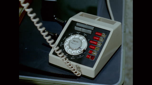 vidéos et rushes de cu woman dialling number on landline phone / united states - style rétro