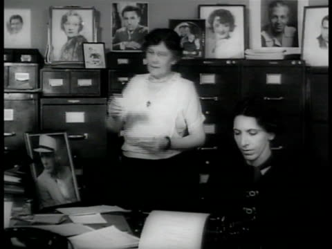 dramatization woman dictating joke to younger woman typing cu typewriter paper'actor with most hair on chestrin tin tin' - chest hair stock videos and b-roll footage