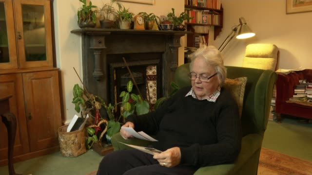 woman discovers half-sister and identity of father after uploading dna to genealogy website; england: hull: int various shots of rilba jones looking... - multi generation family stock videos & royalty-free footage