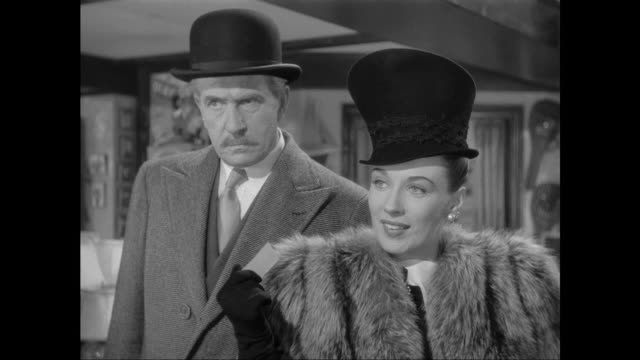 1946 woman (patricia morison) discovers sherlock holmes has beaten her to music box purchase - thank you stock videos and b-roll footage