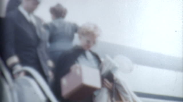 woman disembarks 1950's - archives stock videos & royalty-free footage