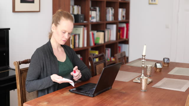 woman disinfecting her laptop during corona virus pandemic - rubbing alcohol stock videos & royalty-free footage