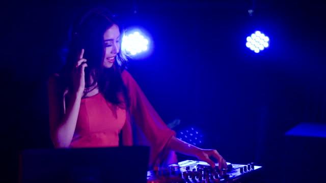woman dj jockey mixing music at night club - club dj stock videos & royalty-free footage