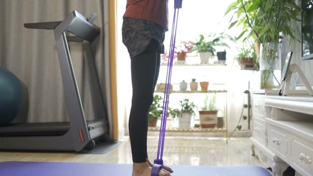 woman do exercising at home - fitness ball stock videos & royalty-free footage