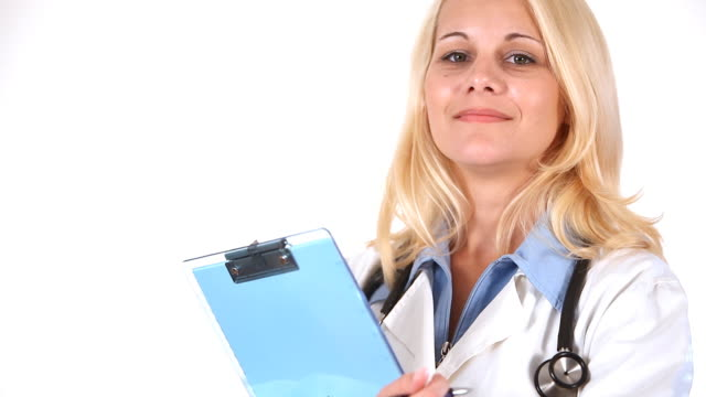 Woman doctor filling medical document