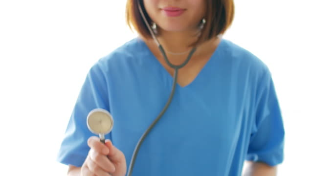 Woman doctor holding Stethoscope on blue Uniform with White background