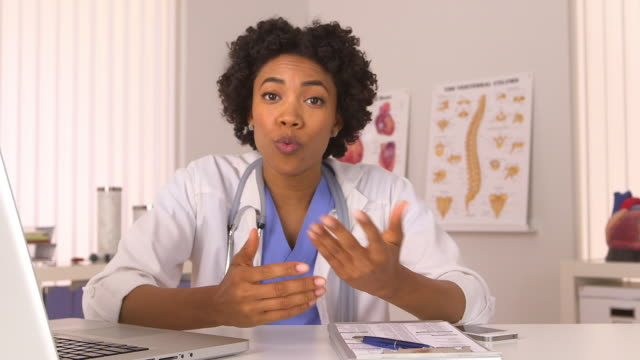 woman doctor talking to camera