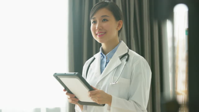 ms woman doctor working on a digital tablet - female doctor stock videos & royalty-free footage