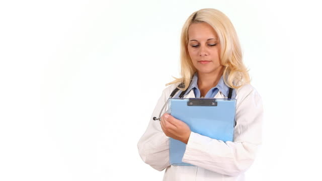 Woman doctor writing