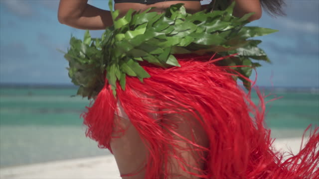 A woman does a hula dance tropical islands in French Polynesia. - Slow Motion