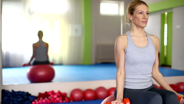 woman doign pilates exercises. - fitness ball stock videos and b-roll footage