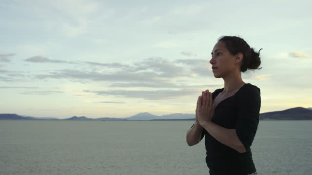 4K UHD: Woman Doing a Prayer Pose while Practicing Yoga in the Desert