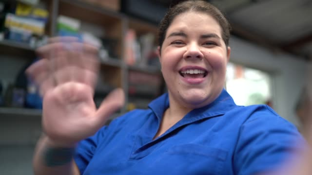 woman doing a video chat at auto car repair - pov of camera - gender stereotypes stock videos & royalty-free footage
